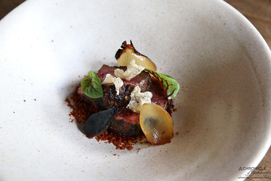 Pablo Honey - Wagyu - charred onion, pinon crust, puffed beef tendon ($16)