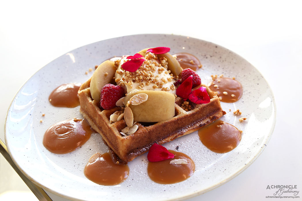 Rustica Canteen Hawthorn - Wholemeal waffle with chai poached apples, salted caramel mascarpone, candied puffed quinoa, flaked almonds ($17)