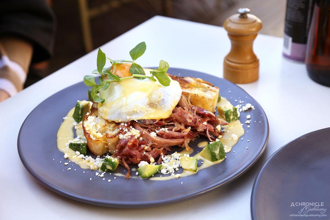 The Resident - Confit Ham Hock w avocado, Yarra Valley feta, hollandaise, fried egg, Turkish bread ($18)