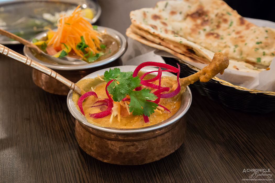 Horn Please - Batak Curry - Roasted leg of duck in tomato cream ragout, fresh turmeric & whole spice bouquet garni ($22) Naan - Plain, Garlic & Chive or Sesame & Onion Seed ($12)