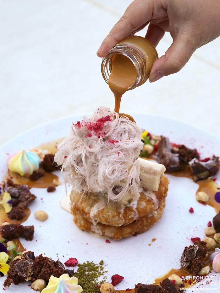The Butler's Den (21) Roti Stack - Double stack of roti hotcake fritters w brownie, banana, strawberry, matcha soil, burnt milk, hazelnut, housemade cookies n cream ice cream, Persian chocolate fairy floss and raspberry crumble ($20)