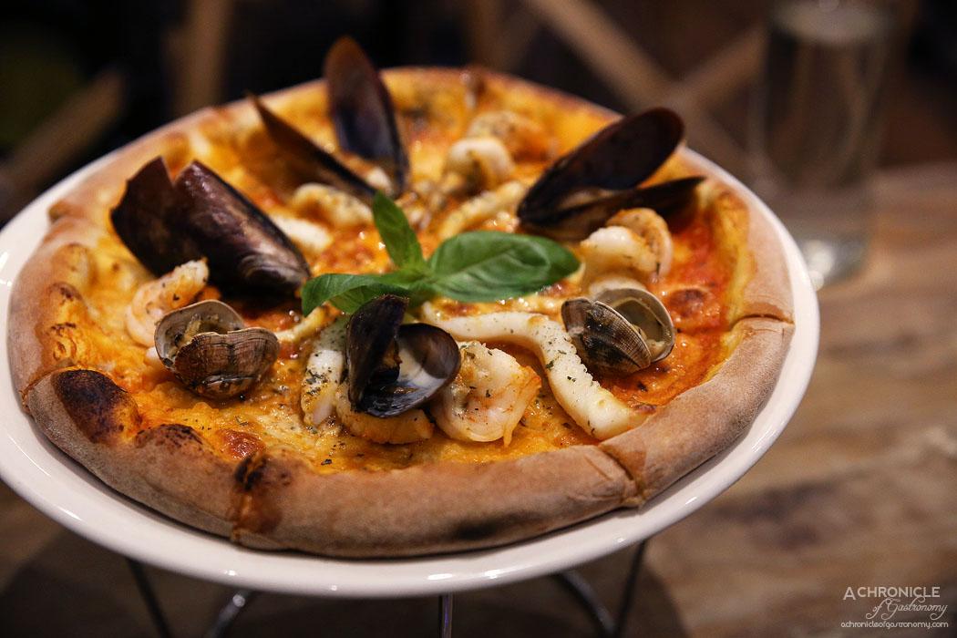 Rubicon - Marinara Pizza - San Marzano tomato, mozzarella cheese, tiger prawns, Hervey Bay scallops, mussels, pippies calamari, garlic oil, oregano, fresh basil ($24.50)