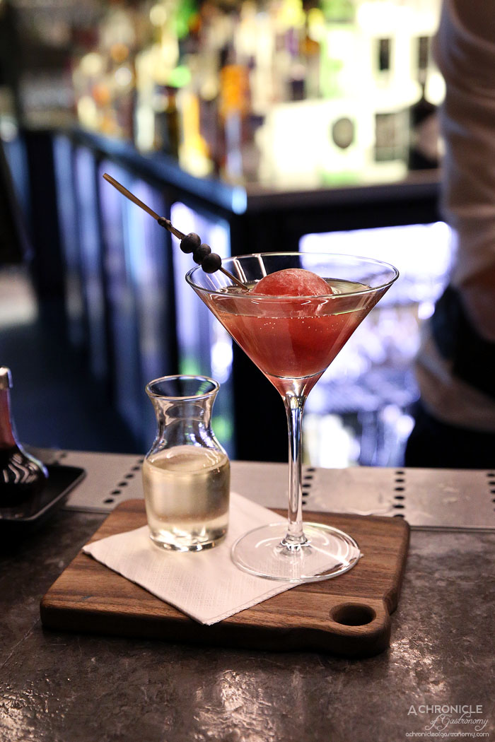 Waterslide Bar - The Tinder Date - Frozen Creme De Mure sphere, fresh berries, yuzu and cointreau, french sparkling
