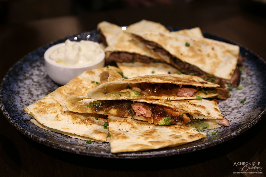 Third Wave Cafe - Pulled Chicken Quesadilla - Grilled tortilla, slow smoked & pulled chicken, Asiago cheese, chives, our house made Sweet Apple Bourbon BBQ sauce, avocado and sauteed onions
