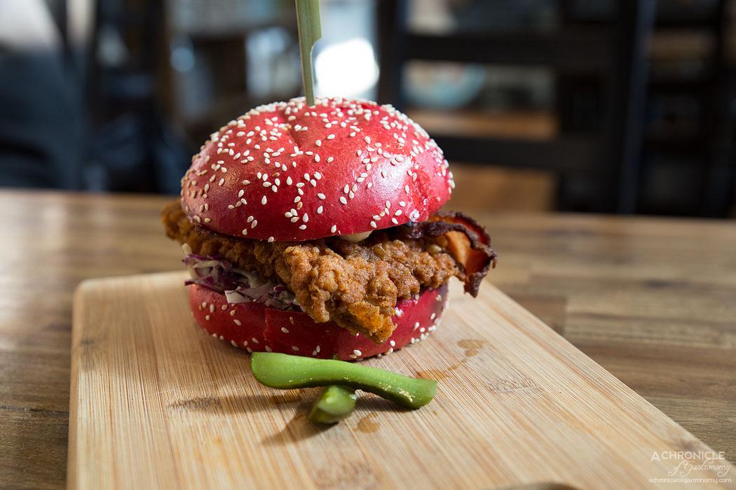 Three One 2 One - Jack da Rippa - Red cabbage slaw, Jack Daniels crispy fried chicken, bacon, red onion, pickles, aioli, red brioche bun ($16.50)