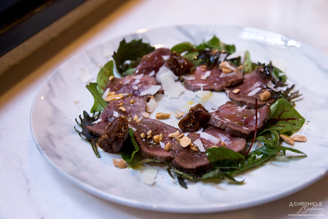 Cecconi's - Roast Venison - Kale, sorrel and rocket salad, macadamia nuts, pecorino cheese with port wine poached figs
