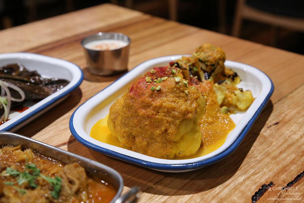 Gobhi Korma - Charcoal roast cauliflower w almonds, raisins, honey and yoghurt ($16) Smoked eggplant raita ($3)