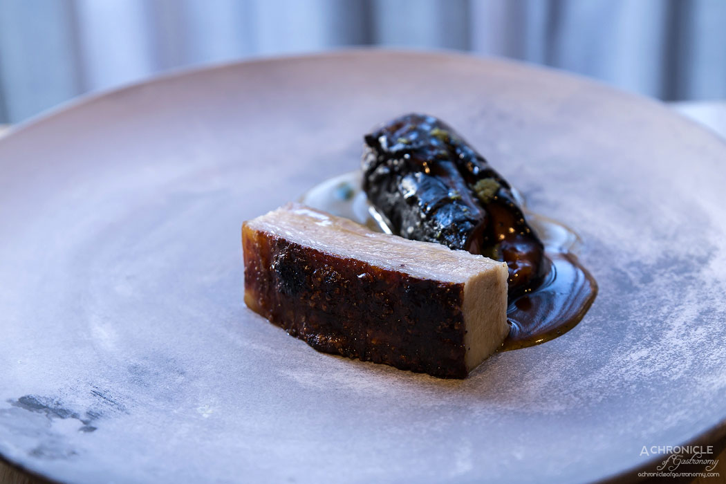 Igni - Pork belly cooked in fermented grains, blackened semi-dehydrated carrot warmed in carrot juice and fenugreek