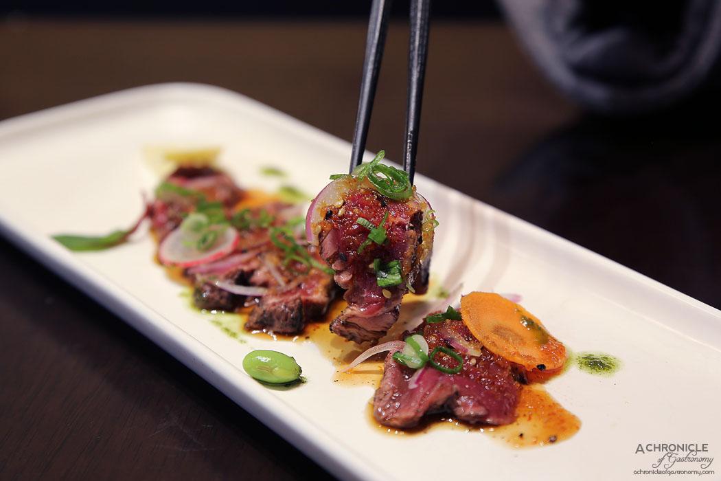 Machi - Beef Tataki - Seared eye fillet with yuzu onion and basil garlic dressing ($19)