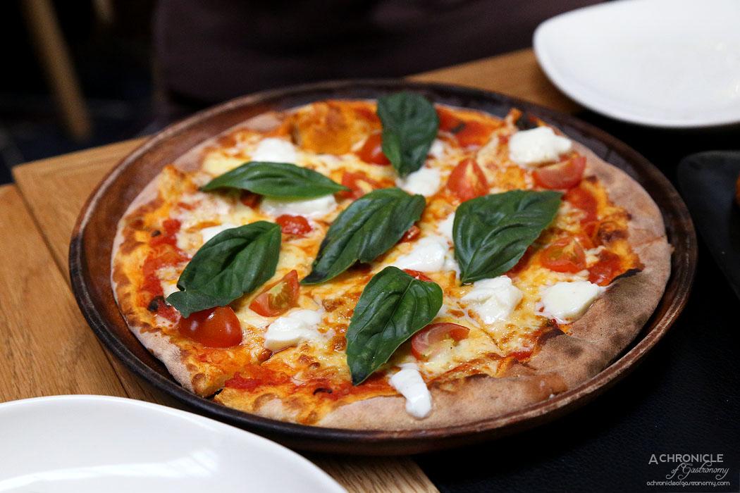 Piccolino - Margherita Di Buffala - Homemade napoli sauce, buffalo mozzarella, fresh basil and cherry tomatoes ($23.50)