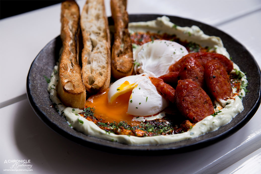 Pillar of Salt - 15th Century Cilbir Eggs - Roasted garlic and herb labne, smoked paprika and cumin spiced burnt butter, toasted turkish bread, add sujuk ($17+5)