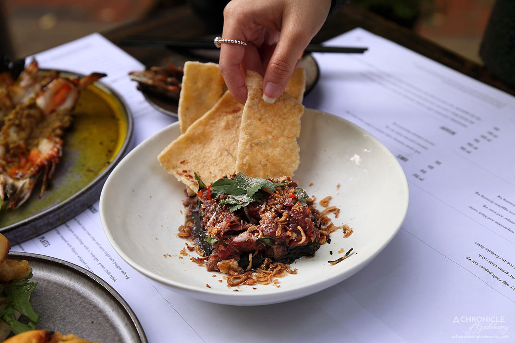 Rice Paper Sister - Isaan style tartar of kangaroo w chilli, fresh herbs, roasted rice and burnt eggplant dressing ($15)