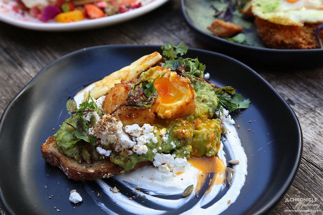 CH James - Smashed Avocado w panko egg, fetta, dukkah spice, garlic yoghurt, chilli oil + grilled halloumi ($18.50+5)