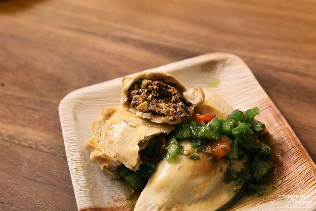 CHE - Traditional beef w minced Gippsland beef, green olives, currants and egg, smoked chicken empanada ($5 ea)