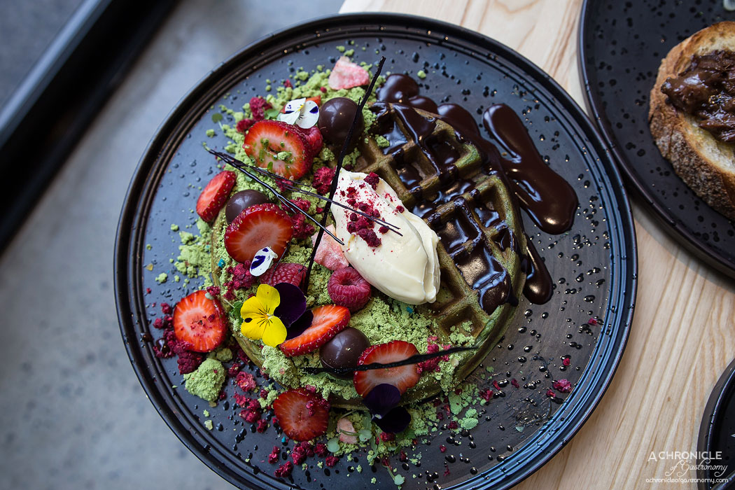 Light Years - Matcha Waffles - Dark chocolate, lemon cheesecake, strawberry, popping candy and space soil ($21)