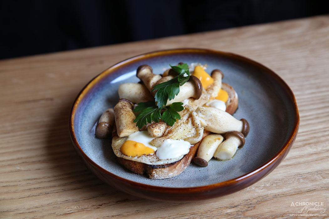 Nomada Cafe Y Tapas - Sauteed mushrooms on sourdough, cured yolk, fresh curd ($17)