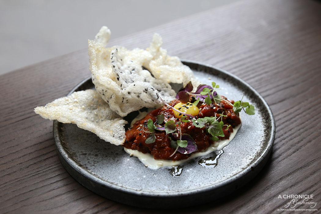 Homi Noodle Bar - Spicy beef tartare w laoganma oil, nashi pear, quail egg & horseradish cream ($17.50)