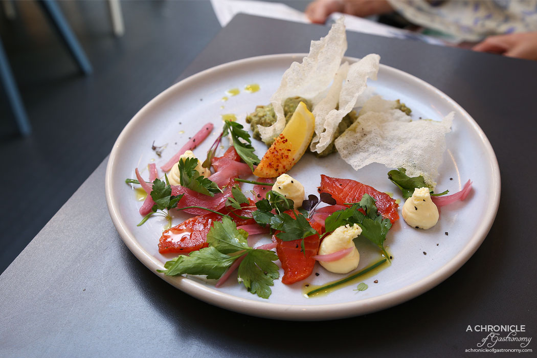 Speakeasy - Spiced cured ocean trout w crispy rice paper, pickles & citrus cream cheese ($15)