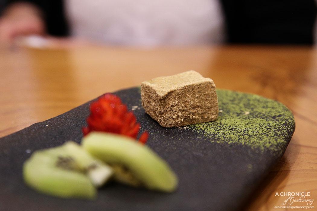 Fujitei - Kuro Goma Panna Cotta - Black sesame panna cotta dressed roasted rice flour and dusted with green tea powder ($10)