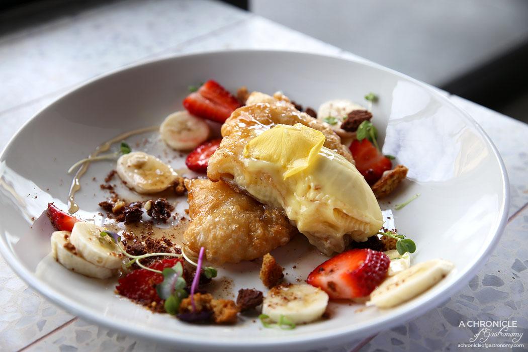 Monroe - Crispy Banana Roti - Banana filled roti, pan-fried w mascarpone, biscuit crumb, strawberries ($18)