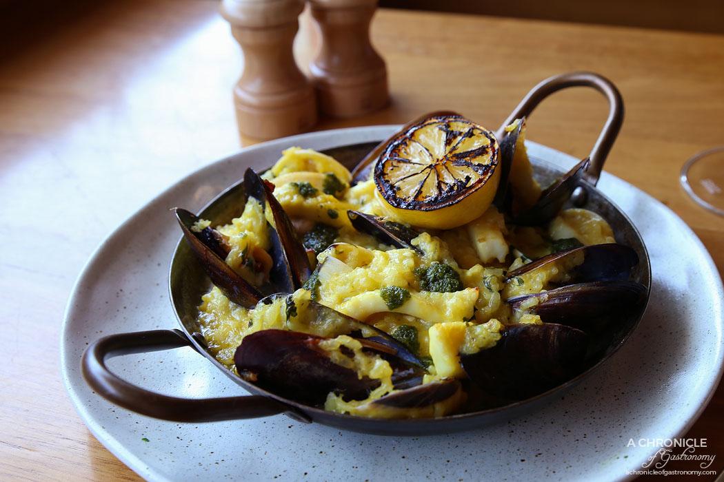 Osteria 20 - Seafood Risotto Al Forno baked in claypot w mussels, clams, cuttlefish, white wine, saffron ($29)