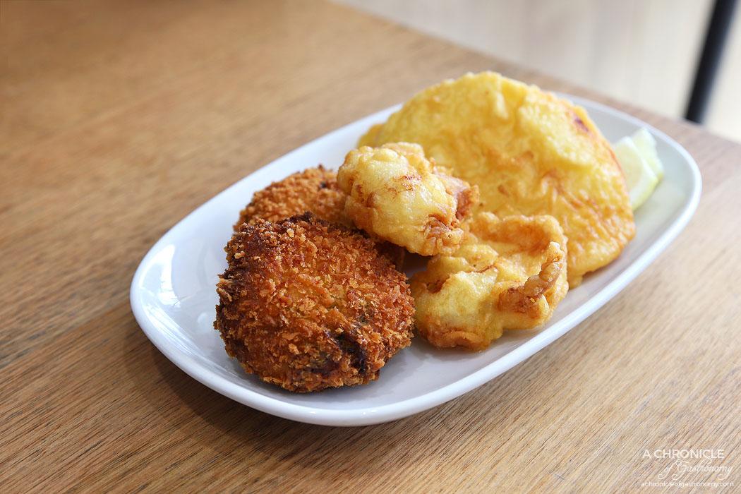 At The Catch - Potato Cake ($1,30 ea), Bay Scallops ($2.50 ea), Greek Fish Cakes