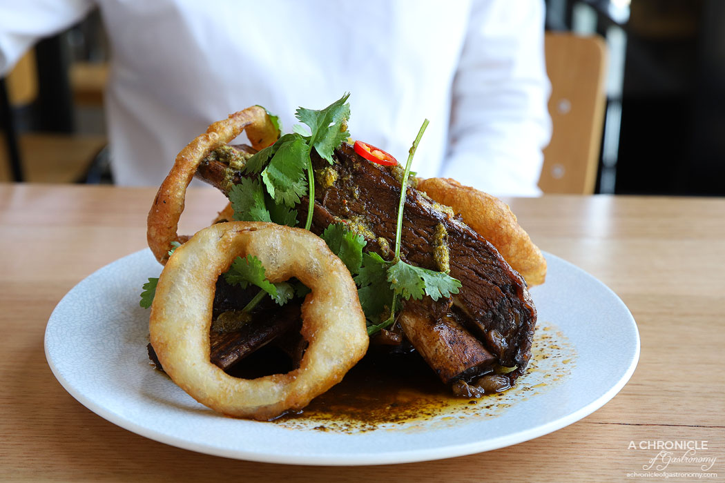 Two Fat Monks - Braised Bourbon Beef Ribs - Slow-cooked beef short ribs, onion rings, chimichurri ($24)