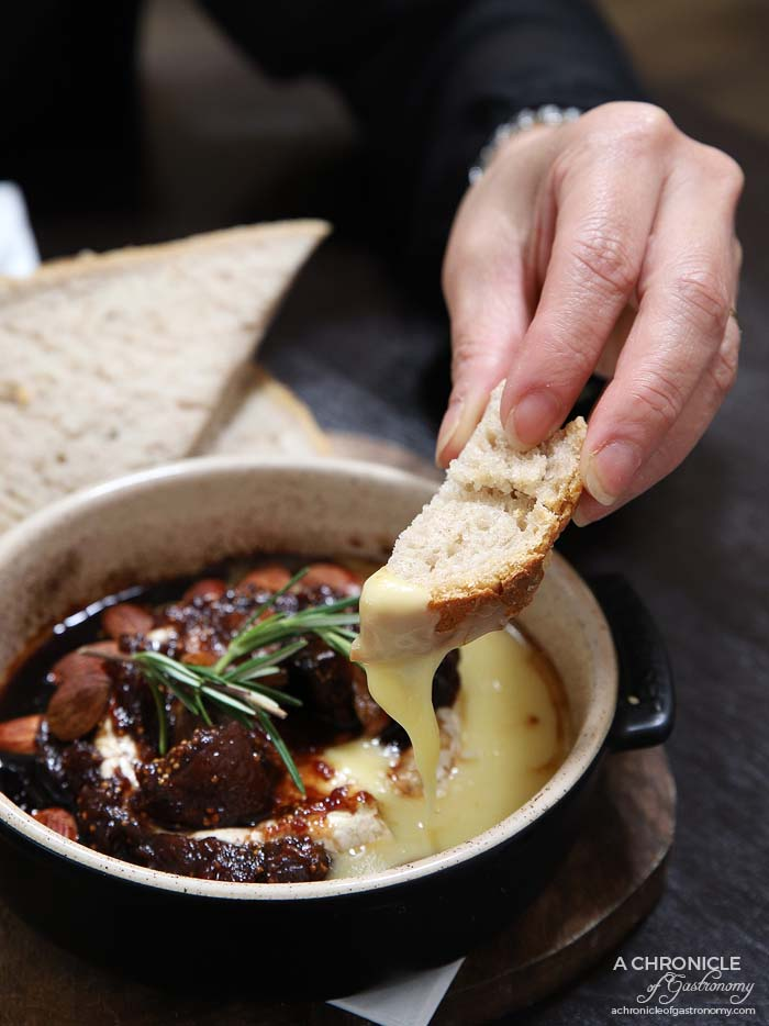 Spencer and Co - Baked brie - Bathed in grand tawny port, fig compote, almonds and rosemary ($21)