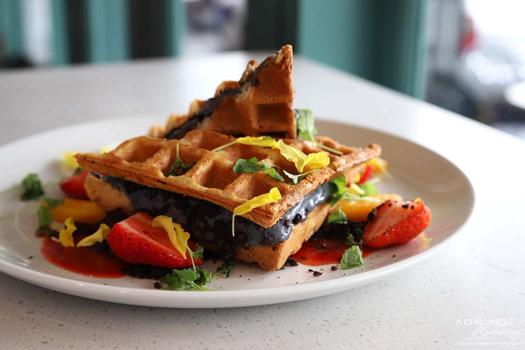 Tamper - Waffle Ice Cream Sandwich - Belgium waffle w black sesame ice cream, fresh mango and strawberry puree w peanut praline ($18)