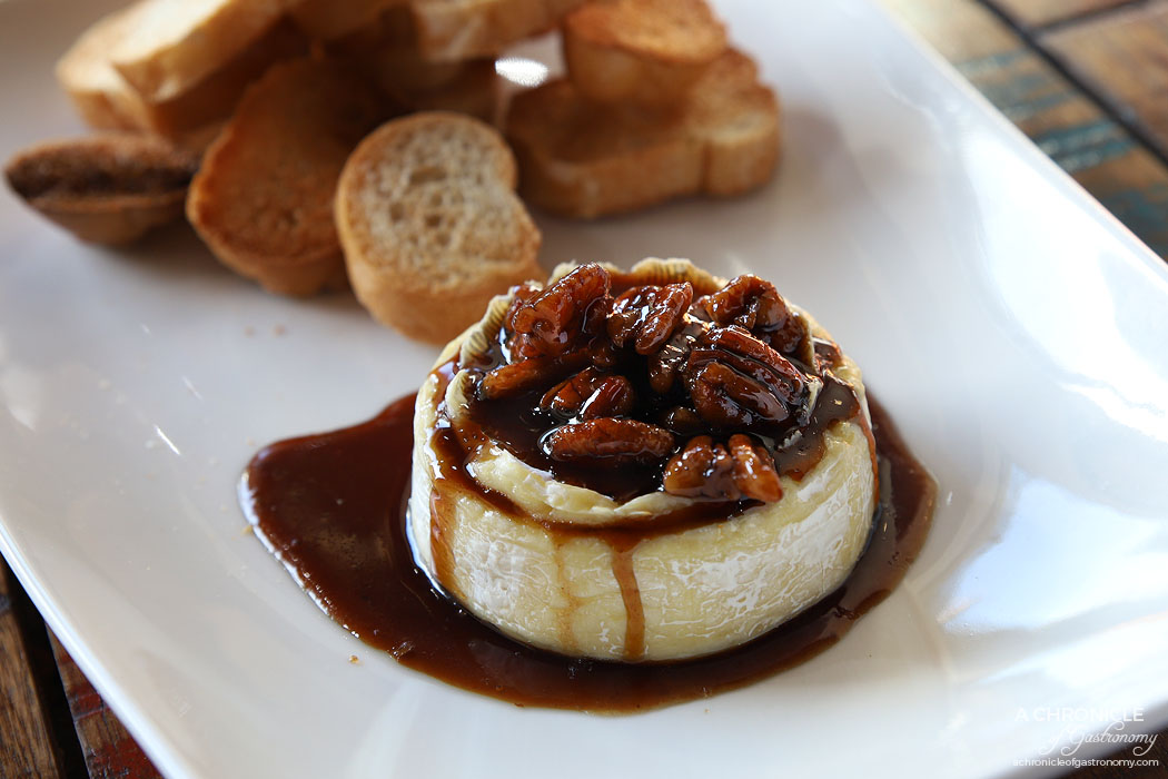 The Moldy Fig - Kahlua Pecan Baked Brie - Whole wheel of triple cream brie with sticky Kahlua and pecan sauce ($18)