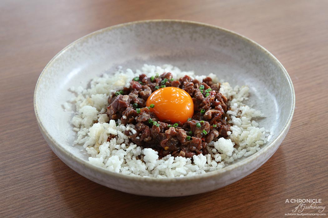 Jamu - Raw Beef w smoked egg, chilli oil, laughing cow, puffed rice ($20)