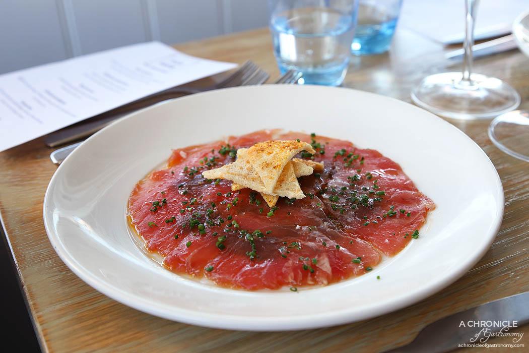 Pier Farm - Tuna Carpaccio - Yellow fin tuna, olive tapenade, tomato confit, Melba toast