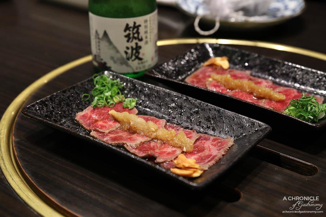 Takumi - Beef tataki, signature onion ponzu