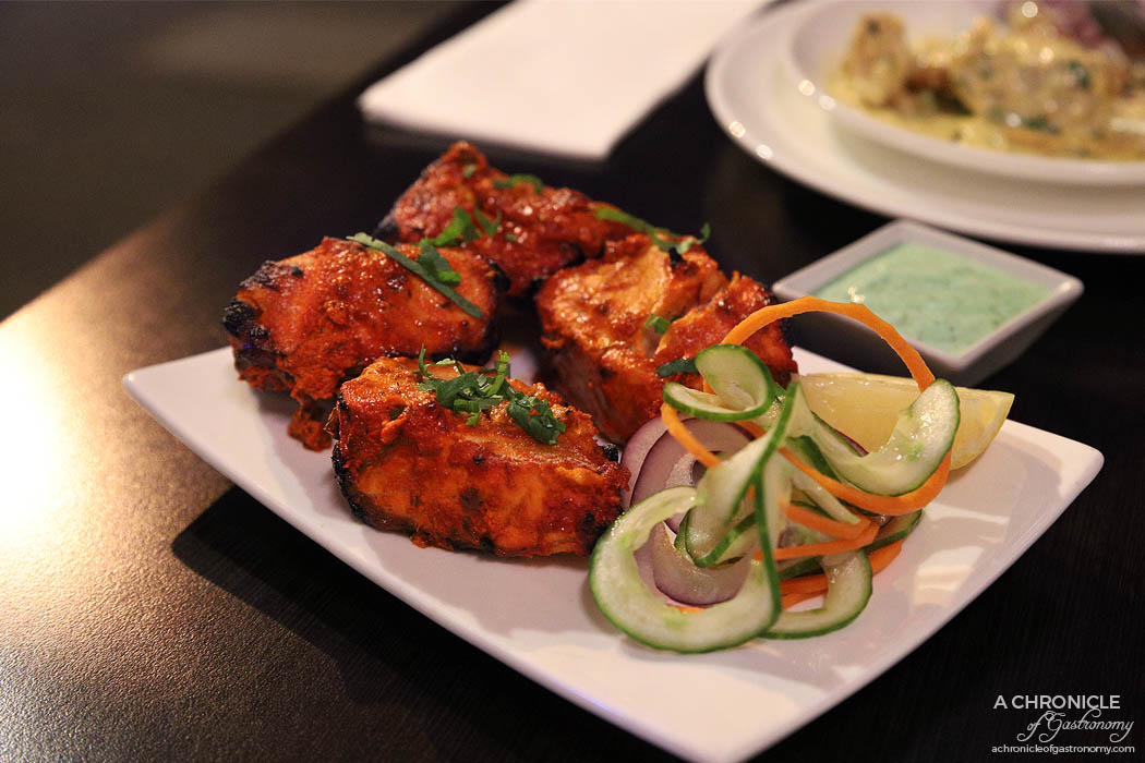 Curry Smuggler - Salmon Tikka - Fillet marinated in tandoori spices and yoghurt and cooked in the tandoori oven ($21)