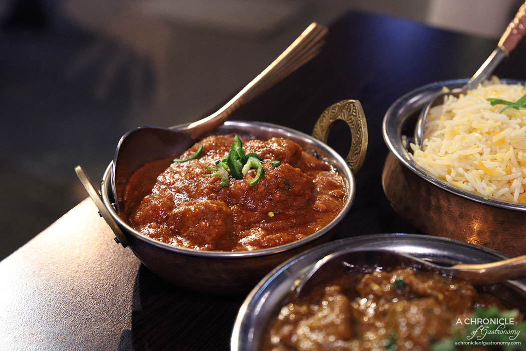 Curry Smuggler - Beef Vindaloo - Cooked with hot chilli, spices and vinegar in a special sauce ($19)