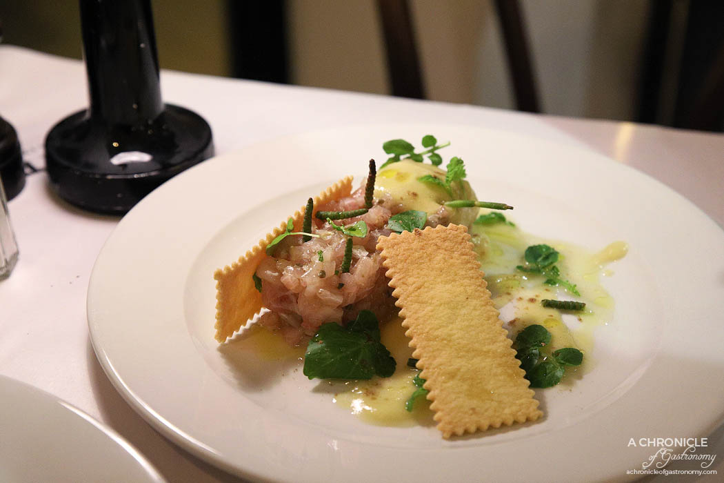 Spinetoli - Kingfish tartare, olive oil cracker, cucumber salt, with herbs and sprouts ($19)