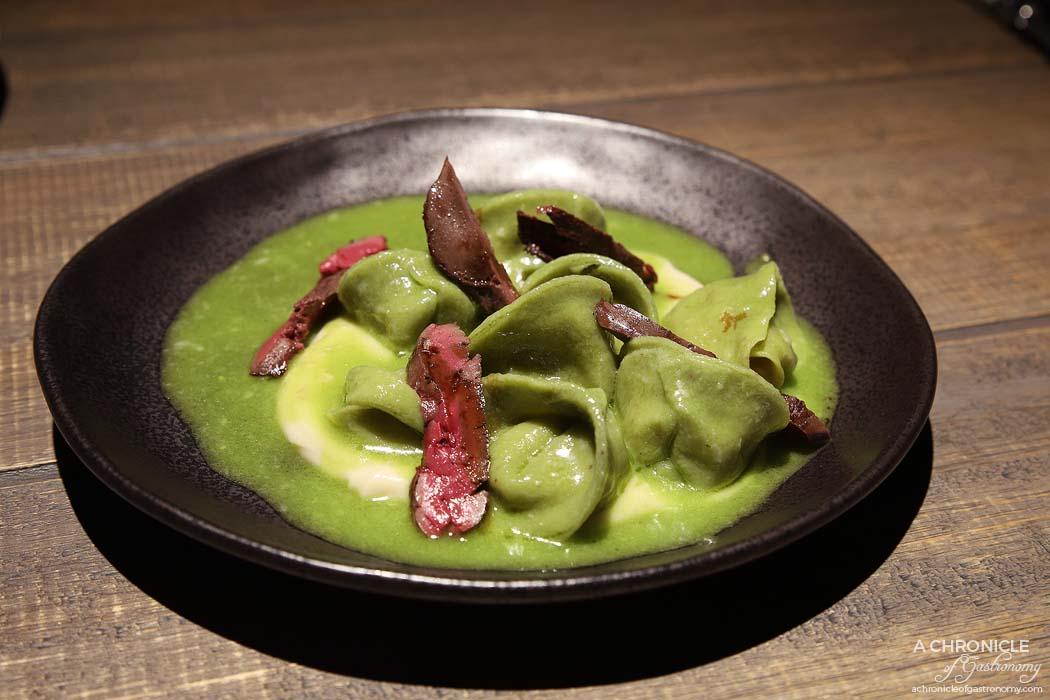 Osteria Ilaria - Pistachio and celeriac tortellini, basil emulsion, smoked chicken livers, aged balsamic ($28)