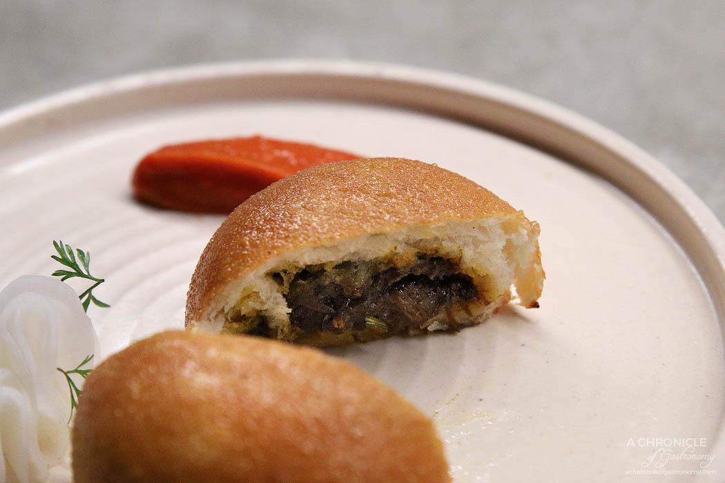 Sunda - Wagyu rendang bun, pickled radish, fermented sambal ($9)
