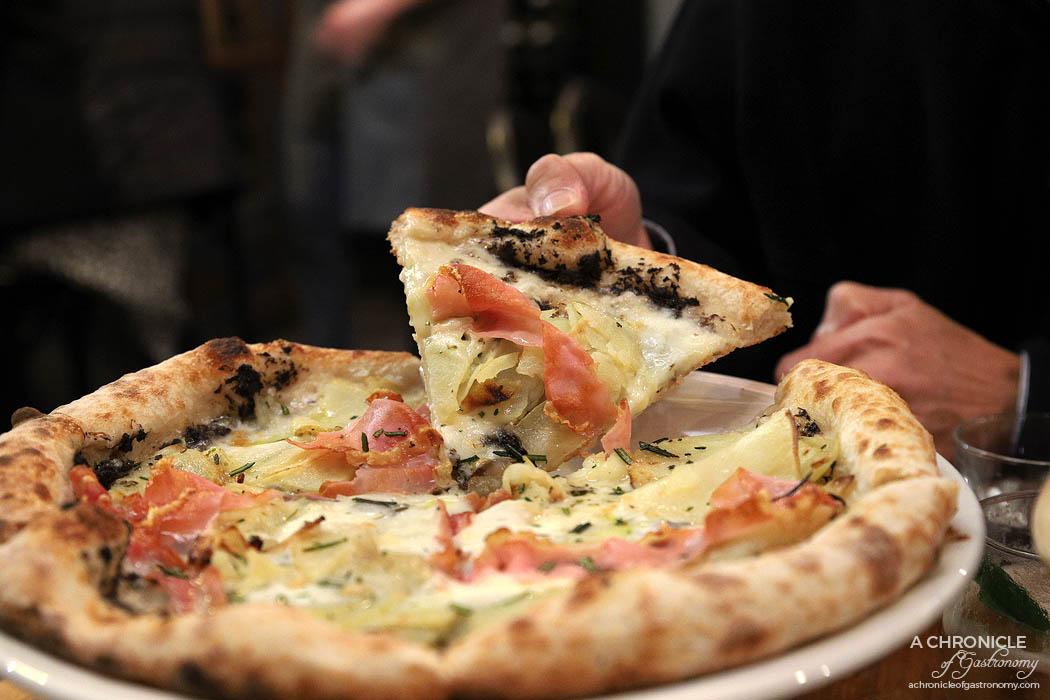 Pizza Farro Fitzroy - Patate e Tartufo Pizza - Black truffle sauce, mozzarella, taleggio D.O.P., potato, pancetta & rosemary ($23,50)