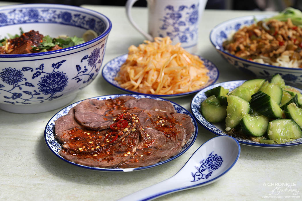 Lanzhou Beef Noodle Bar - Spicy beef slices ($5), Chicken giblets with peanuts, Bean curd ($3,50), Shredded potatoes ($3,50), Shredded cucumber with sauce ($3,50), Special pickled cabbage ($3,50)