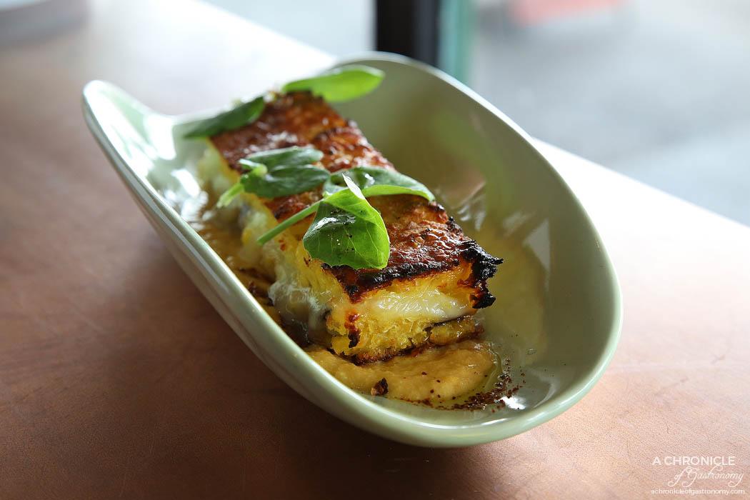 Citrico - Pastel de Choclo - Corn, eggplant terrine, humita sauce, watercress, charred provolone cheese ($16)