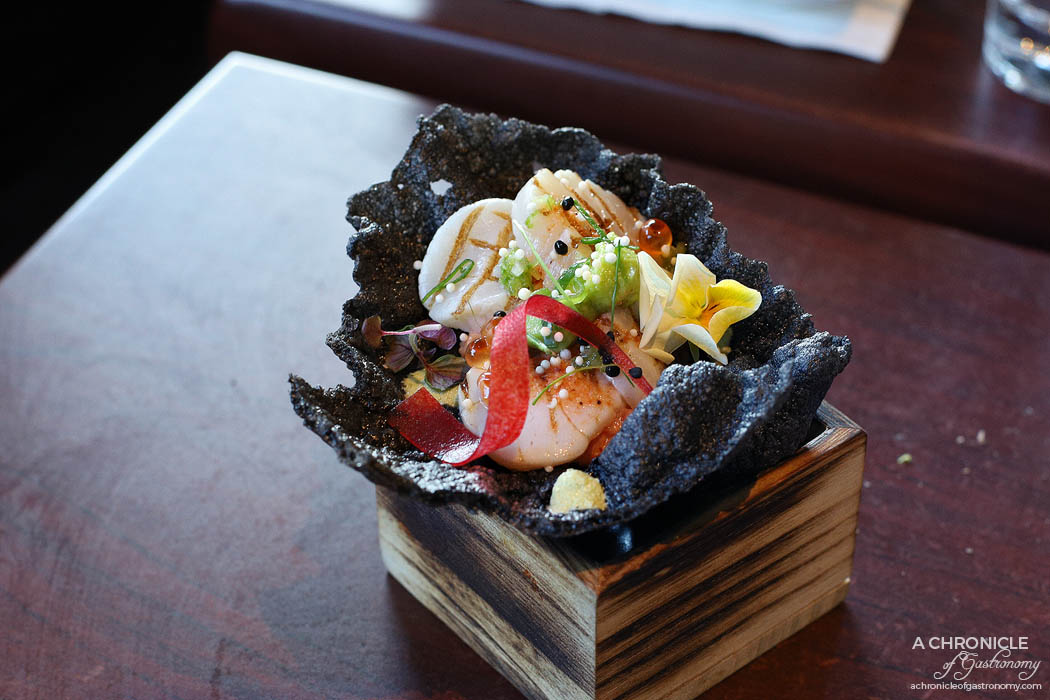 Machi - Scallops, crab meat on black cracker