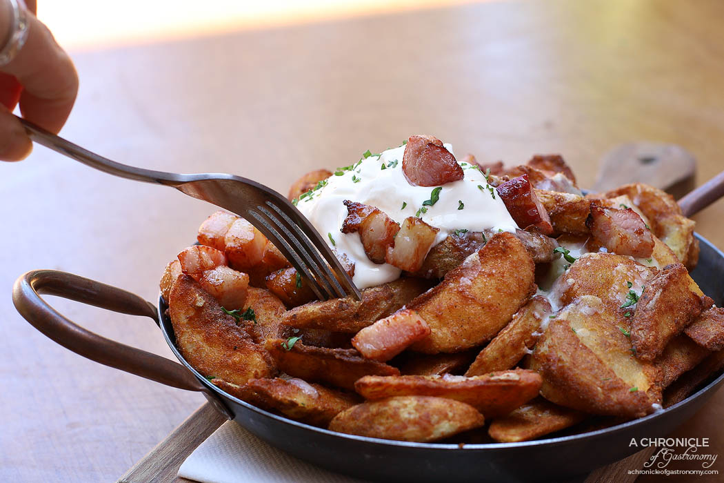The Coventry - Coventry Wedges - Crispy wedges topped with bacon bits, melted cheese and sour cream ($13.50)