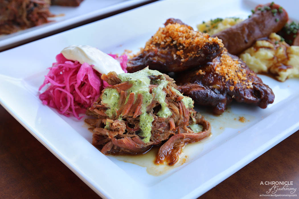 Bluestone American BBQ - Cuban style pulled pork, Tangy creole slaw, Applewood chicken chops, Smoked cheddar sausage, Stone ground grits
