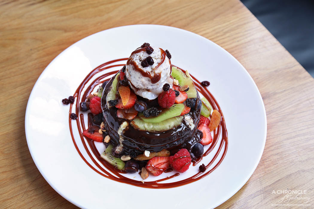 High Society - Pancake Stack - Buttermilk pancakes with poached pear, mascarpone, nuts, vanilla ice cream, fresh fruits, coverture chocolate sauce ($19)