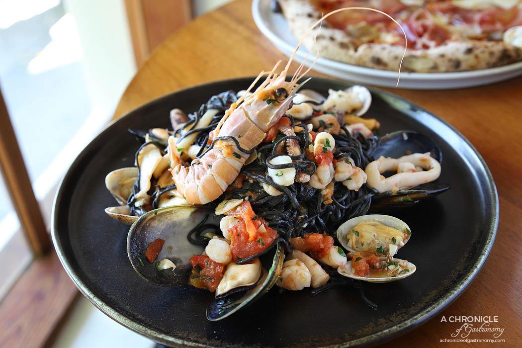 Il Caminetto - Black taglioni alla pescatora - Black ink homemade pasta w calamari, prawns, scampi, vongole, mussels and garlic, served with fresh tomato sauce ($29)
