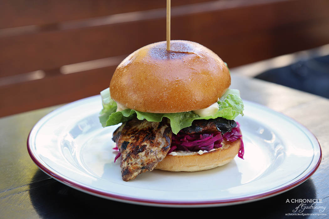 Gabriel - Jerk chicken roll with pickled red cabbage, cream cheese and baby cos ($17)