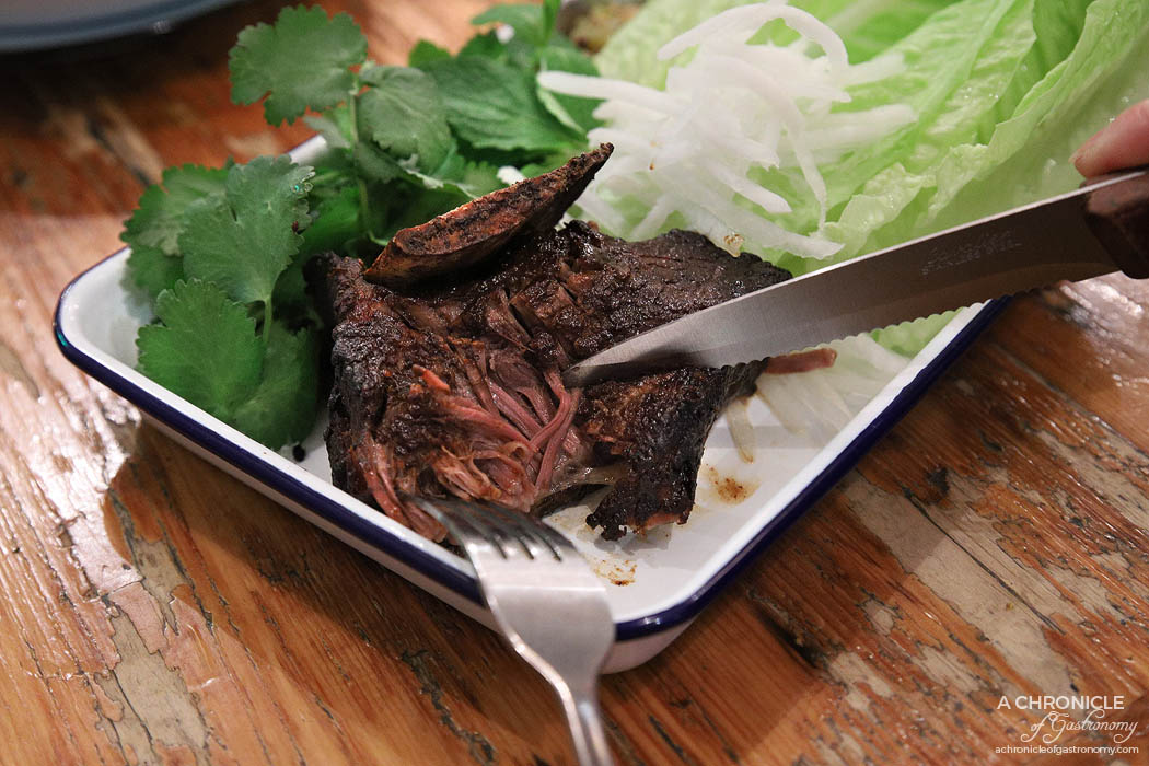 Queen Vee's - Miso & Tamarind Glazed Short Ribs w. green tomato pickle, pickled cucumber & lettuce cups ($24)