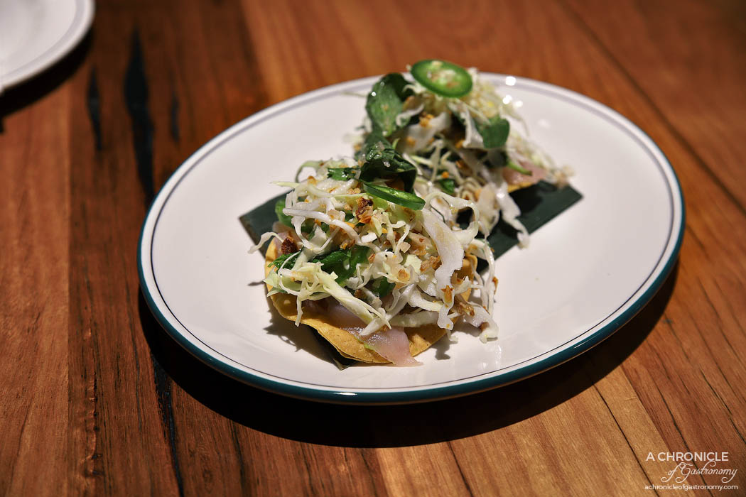 The Black Toro Windsor - Kingfish Ceviche Tostada - Crispy tostada, lime cured kingfish, guacamole, toasted peanut slaw (2 for $14)