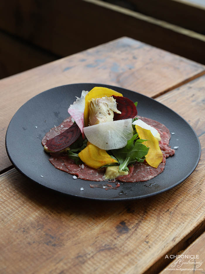 Shop 225 - Carpaccio - Thinly sliced cured beef fillet served with beetroot, roquette, artichokes, daikon in a mustard vinaigrette dressing ($17)